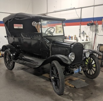 AAMCO Newport, OR - Black Antique Car