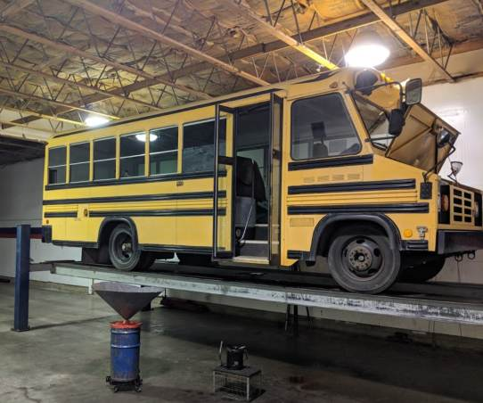 AAMCO Newport, OR - Bus on the Automotive Lift
