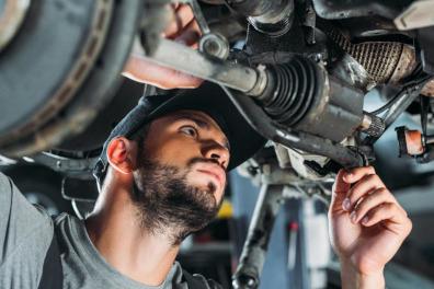 Mechanic Inspection a car's underside