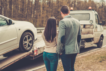 Couple by a tow truck