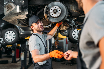 Smiling mechanic shaking hands
