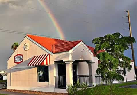 AAMCO Venice, FL exterior with rainbow